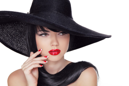 sexy mouth: Beauty Vogue Style Fashion Model Girl in black hat. Manicured nails and Red Lipstick. Isolated on a white Background.