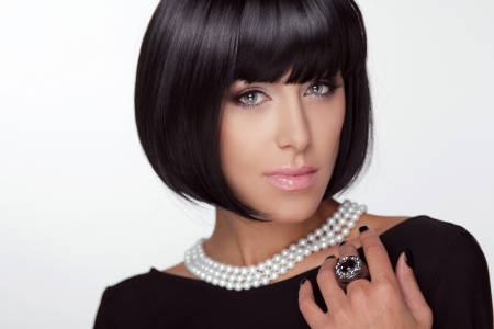 Fashion Haircut. Hairstyle. Sexy Lady. Stylish Fringe. Short Hair Style. Brunette woman with jewelry pearls Stock Photo - 22615382