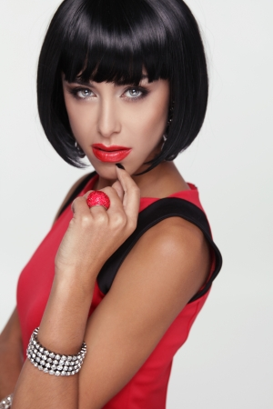 Sexy beauty brunette woman. Makeup. Stylish Fringe. Black Short Hair Style. Jewelry. Fashion photo Stock Photo - 23298045