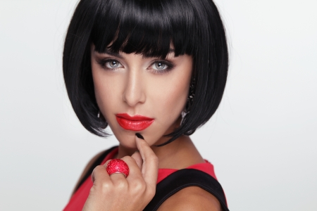 Sexy beauty brunette woman with Red Lips. Makeup. Stylish Fringe. Black Short Hair Style. Jewelry. Fashion photo Stock Photo - 22615397