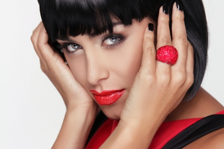 Sexy beauty brunette woman with Red Lips. Makeup. Stylish Fringe. Black Short Hair Style. Jewelry. Fashion photo Stock Photo - 22615399