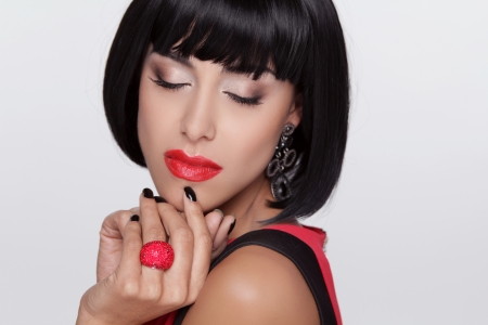 Sexy beauty brunette woman with Red Lips. Makeup. Stylish Fringe. Black Short Hair Style. Jewelry. Fashion photo Stock Photo - 22615400