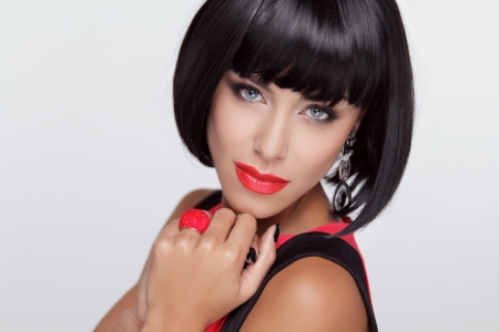 Sexy beauty brunette woman with Red Lips. Makeup. Stylish Fringe. Black Short Hair Style. Jewelry. Fashion photo Stock Photo - 22615401