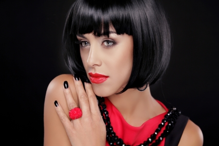 Fashion Brunette Woman Portrait with Red Lips isolated on a black background. Showing ring Stock Photo - 22615403