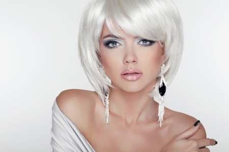 Beauty Girl Portrait with Makeup and White Short Hair showing  Earring Jewelry Accessories.