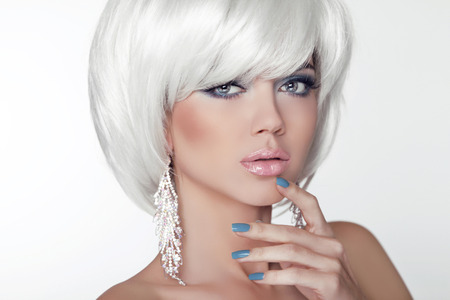 Fashion Beauty Girl Portrait with White Short Hair. Jewelry. Haircut and Makeup. Hairstyle. Make up. Vogue Style. Sexy Glamour Model