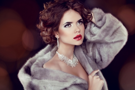 Beauty Fashion Model Woman in Mink Fur Coat. Winter Girl in Luxury Fur Coat and Diamond Jewelry Necklace