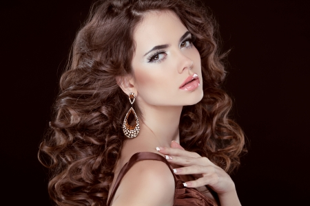 Wavy Hair. Beautiful Sexy Brunette Woman. Healthy Long Brown Hair. Beauty Model Girl. Earring. Studio photo