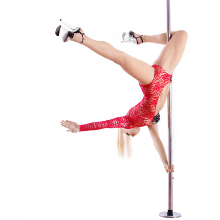 Young slim pole dance woman. Performance. Sexy girl Isolated on white background. Studio Photo photo