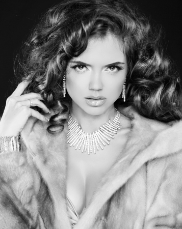 Black and white photo Beautiful lady wearing in mink fur coat  photo