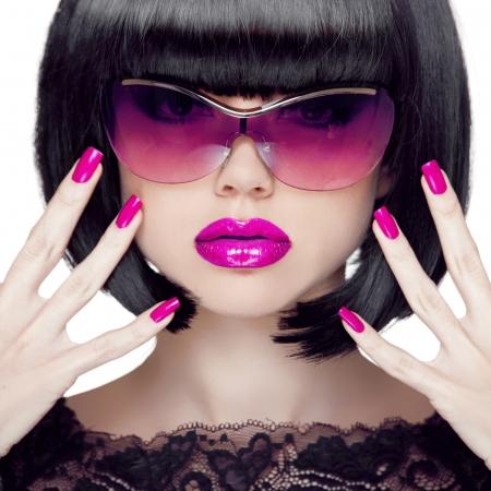 Colorful Make up. Closeup portrait. Purple sexy lips. Manicured polish nails. Luxury Brunette Woman wearing in Fashion Sunglasses. Black short hair style. Stock Photo - 24106322