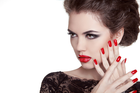 Glamour Fashion Woman Portrait. Manicured nails. Red lips. Make up. Isolated in white  Stock Photo - 24106323