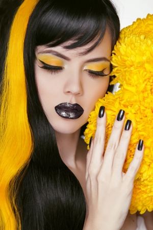 punk hair: Punk Girl Portrait with Colorful Makeup, Long Hair, Nail polish. Manicure and Hairstyle. Black and yellow Colors Stock Photo