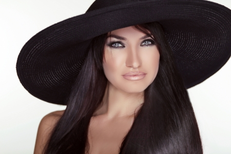 Fashion brunette woman model posing in black hat isolated on white background Stock Photo - 24180706