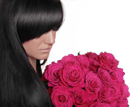 Brunette woman with fringe holding pink bouquet of roses isolated on white background. Long hair style. Hairstyle. Stock Photo - 24101611