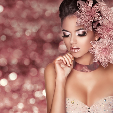 Beautiful Girl With Pink Flowers. Beauty Model Woman Face. Isolated on bokeh lights Background.  Perfect Skin. Professional Make-up. Makeup. Fashion Art. Reklamní fotografie - 24661415