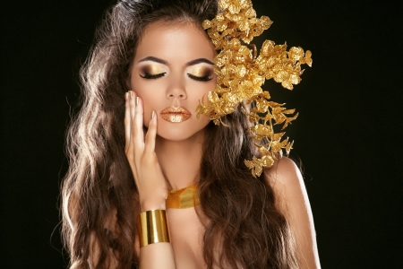 Fashion Beauty Girl Isolated on Black Background. Makeup. Golden Jewelry. Hairstyle. Vogue Style. Decorative elements