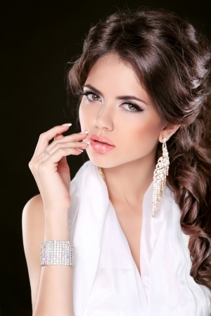 Glamour Fashion Woman Portrait Of Beautiful brunette with long hair. Jewelry accessories.