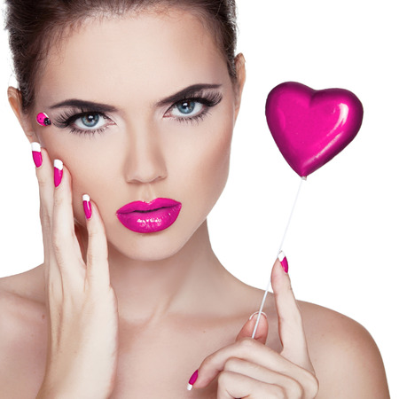 Bright makeup. Beauty Portrait. Beautiful  Woman Touching her Face. Perfect Fresh Skin. Pure Beauty Model. Skin Care Concept  Stock Photo