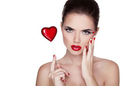 Beauty Portrait. Beautiful Spa Woman with red lips, manicured polish nails isolated on white background. Valentines day concept  photo