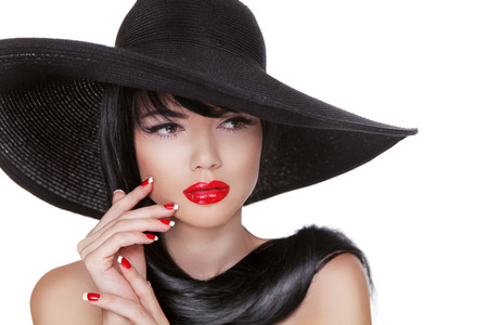 sexy mouth: Glamour Fashion Brunette Woman Portrait in black hat isolated on White background. Makeup. Manicured nails.