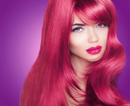 Red Long Glossy hair. Beautiful Fashion Woman Portrait. Bright Makeup. Coloring haired photo