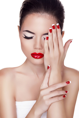 Fashion Beauty Girl. Red lips. Make up. Manicured nails. Attractive Woman isolated on White Background.