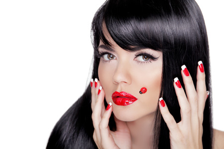 Beauty closeup portrait of brunette girl with professional makeup, red lips, polish manicure nails isolated on white background. photo