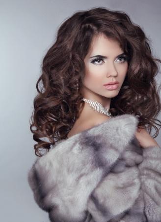 Beautiful Luxury Winter Woman isolated on gray background photo