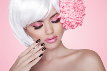 Beautiful Blonde Woman over pink background Stock Photo