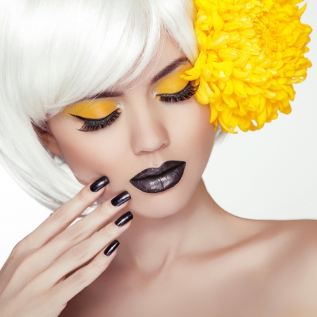 Fashion Blond Model Girl Portrait with Trendy Short Hair style, Black Make up and Manicure photo