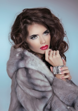 Beauty Fashion Model Girl in Mink Fur Coat.  photo
