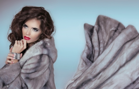 Beauty Fashion Model Girl in Blue Mink Fur Coat. Beautiful Luxury Winter Woman Portrait photo