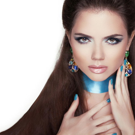 Beauty Fashion Woman Portrait with Jewelry, Makeup and manicured nails photo