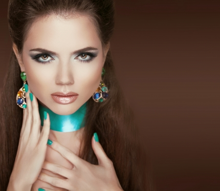 Glamour Fashion Woman Portrait with Jewelry, Makeup and manicured nails photo