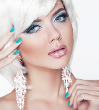 Fashion Beauty Woman Portrait with White Short Hair and Manicured nails. photo