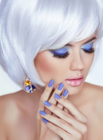 Manicured nails and sensual lips. Blond woman Portrait. White short hair style. Professional makeup. Fashion Beauty Photo photo