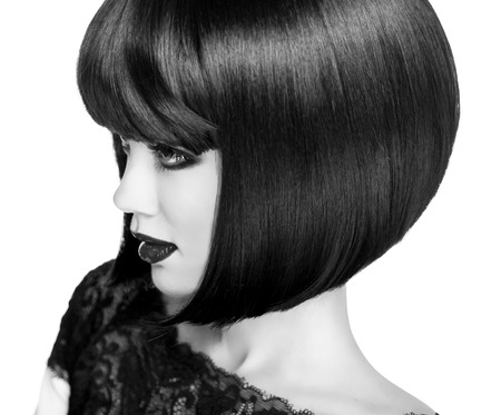 Lady Vamp Style. Brunette Woman close-up Portrait.  Black short hair style. Black and white photo. photo