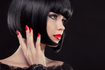 nail studio: Bob short black hairstyle. Manicured nails and red lips. Fashion Beauty Brunette woman Portrait.  Stock Photo