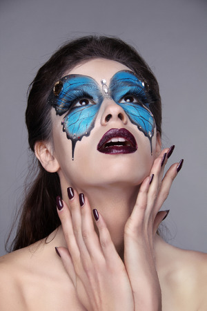Makeup. Manicured nails. Fashion face art portrait. Beautiful model woman posing isolated on gray . Stock Photo - 25663085