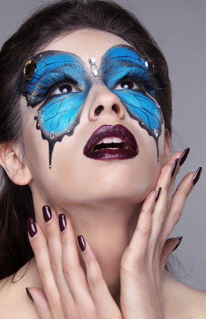 Fashion face art portrait. Manicured nails. Makeup. Beautiful model woman posing isolated on gray . Stock Photo - 25663089