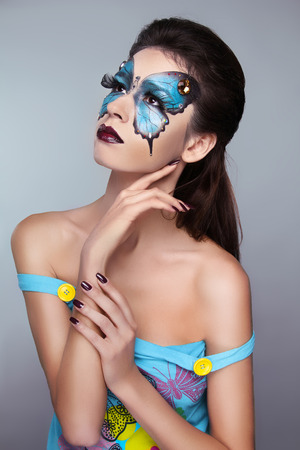 Makeup. Face art portrait. Manicured nails. Fashion female model posing isolated on gray . Stock Photo - 25663106
