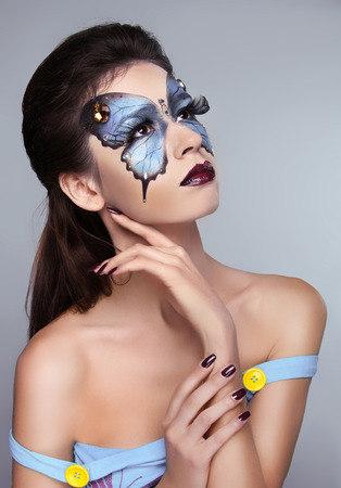 Makeup. Manicured nails. Fashion face art portrait. Beautiful model woman posing isolated on gray . Stock Photo - 25663111