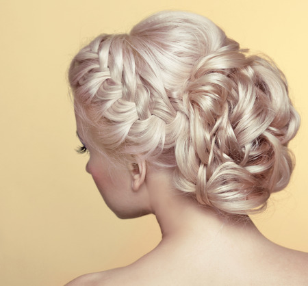 plaits: Beauty wedding hairstyle. Bride. Blond girl with curly hair styling Stock Photo