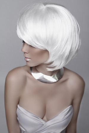 Beauty Fashion Woman Portrait. White Short Hair. Hairstyle. Beautiful Blond girl isolated on gray background. Mulatto model. Make up. Vogue Style. Sexy Glamour female photo
