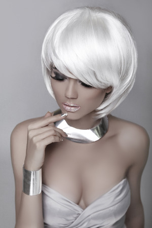 bronzed: Beauty Fashion Woman Portrait. White Short Hair. Hairstyle. Beautiful Blond girl isolated on gray background. Mulatto model. Make up. Vogue Style. Sexy Glamour female