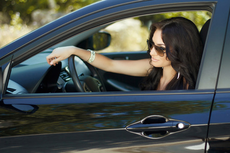 sexy woman car: Brunette woman sitting in car, beautiful sexy female driver