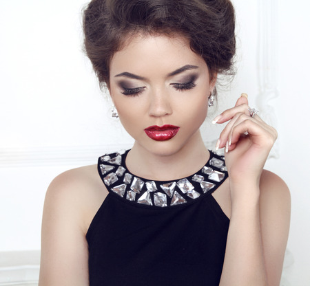 Makeup. Jewelry. Beauty. Brunette woman with red sexy lips, eye shadows.