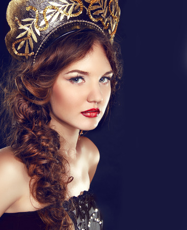 kokoshnik: Beauty Girl with Makeup. Fashion Russian model in exclusive design clothes on manners old-Slavic. Close-up portrait.