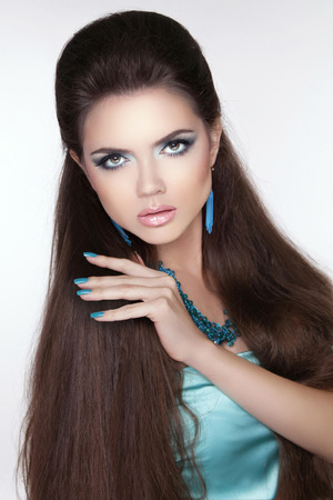 Beauty fashion brunette woman. Long hair styling. Beautiful woman with Professional make-up. photo